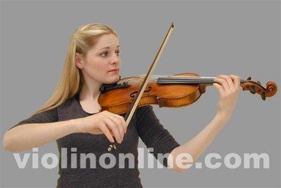 a woman holding a violin